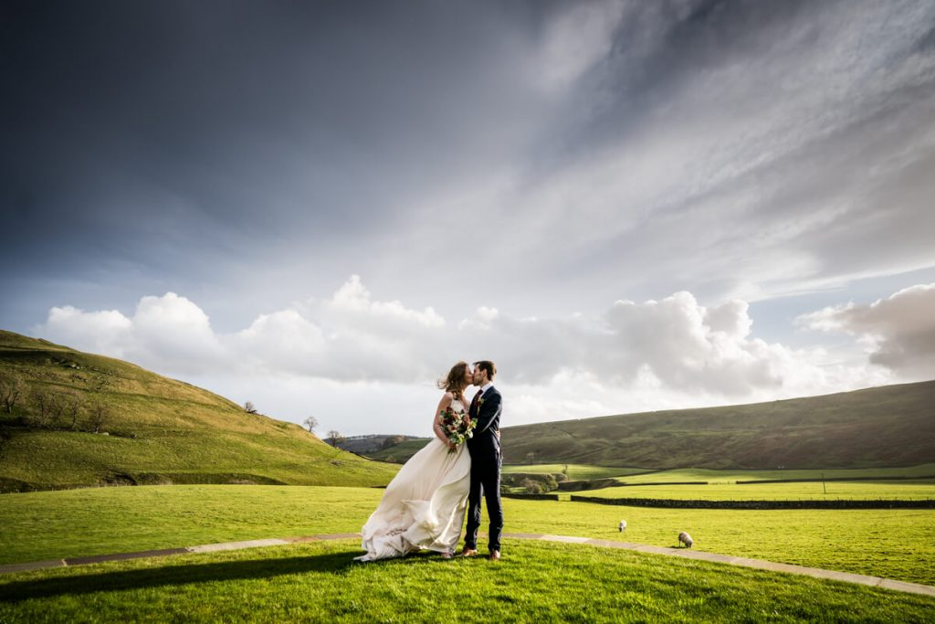 bride and view in front of a dramatic yorkshire dales view at telfit farm