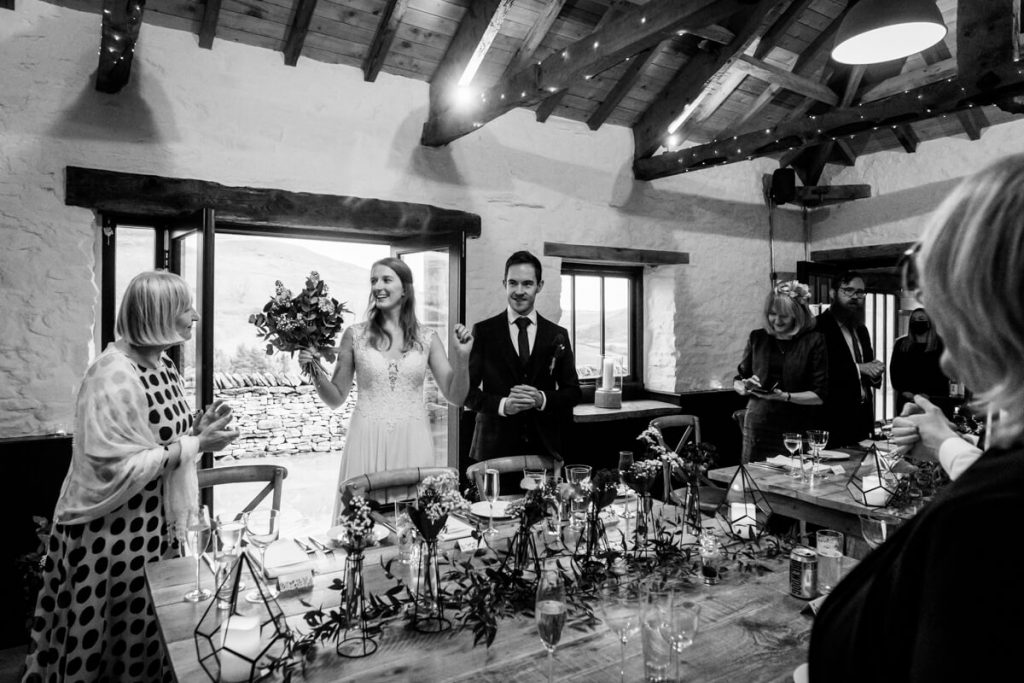 the wedding couple enter the reception room at telfit farm