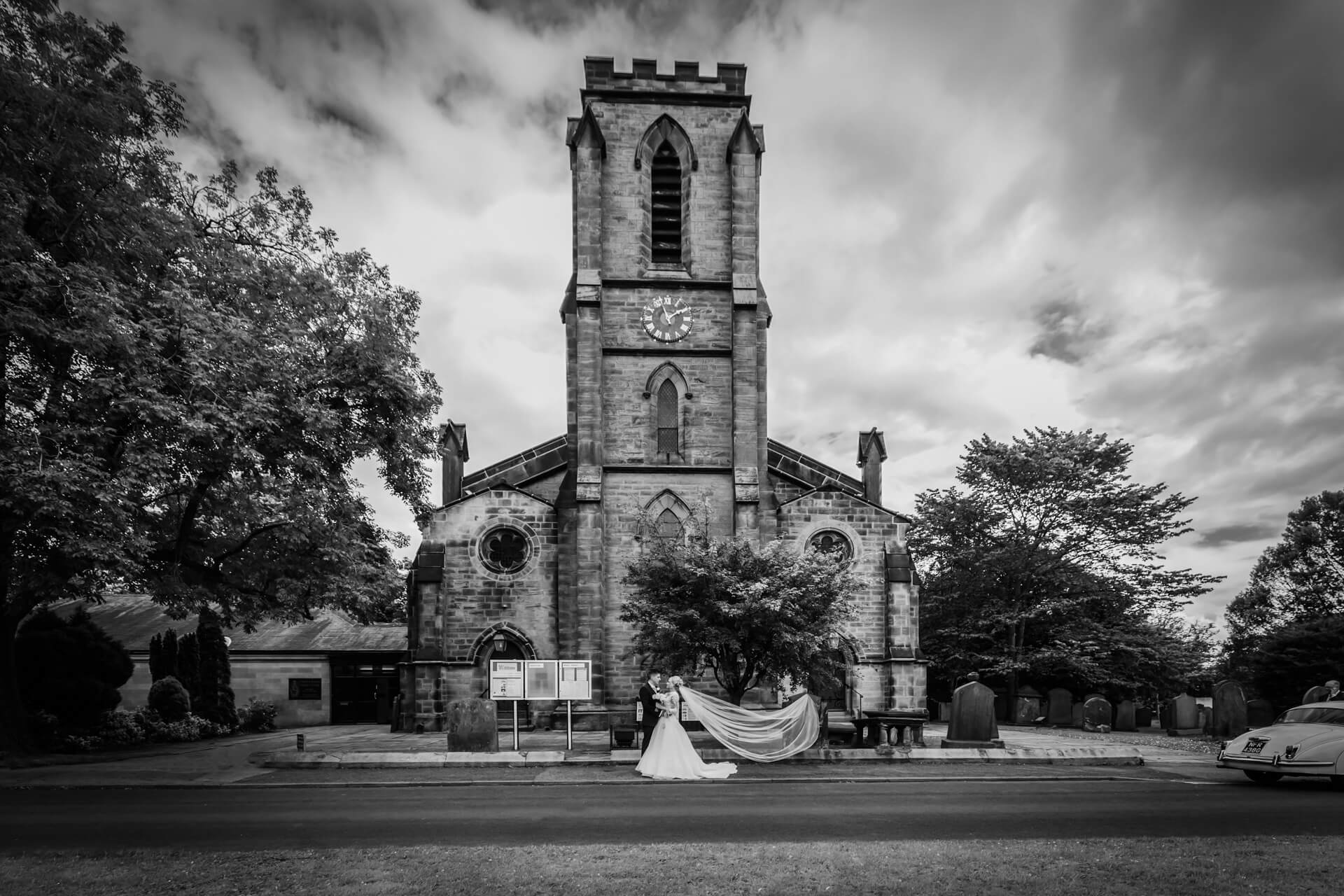 wedding couple standing together outside a harrogate church
