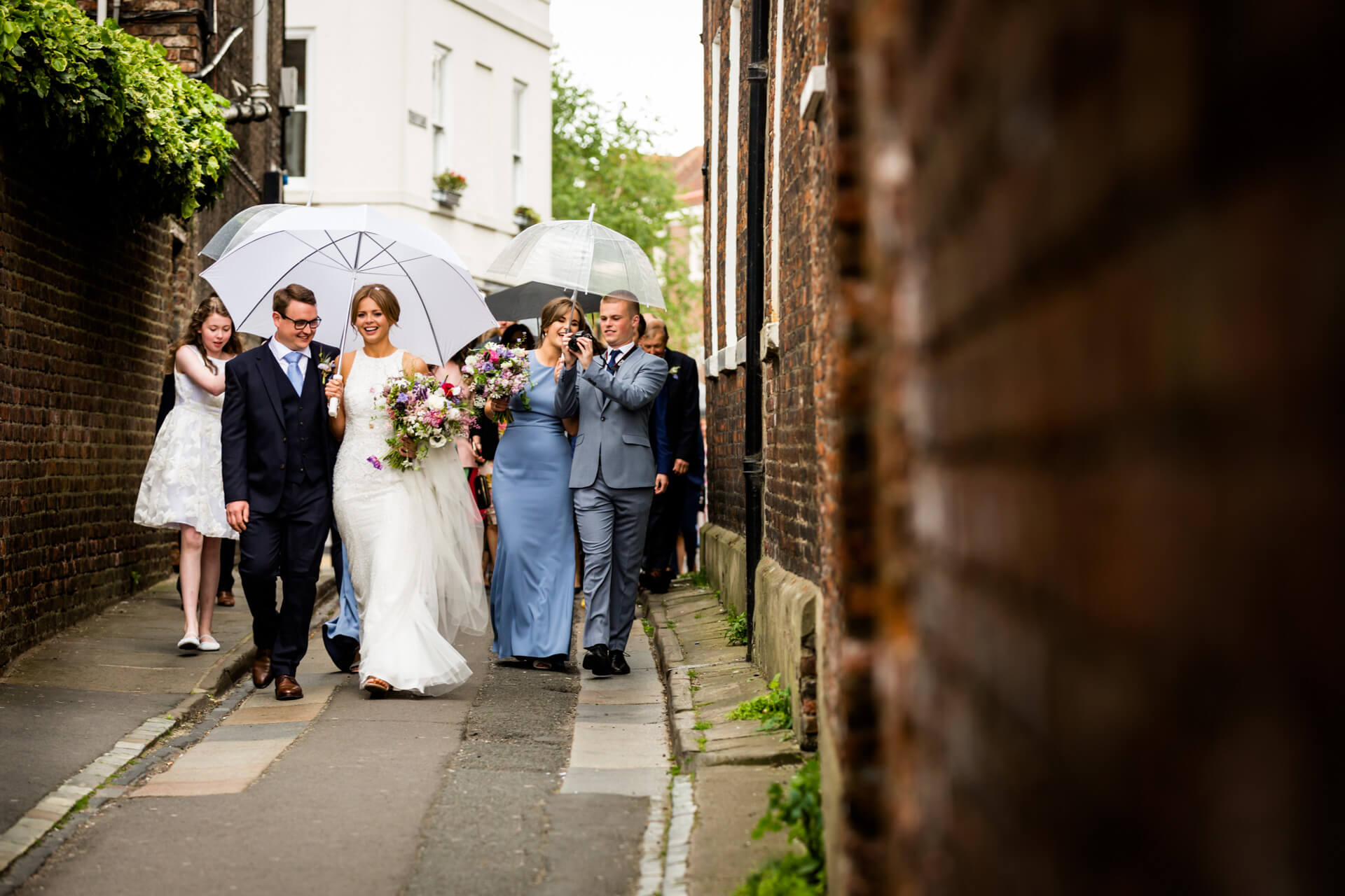 bridal party walking through the streets of york