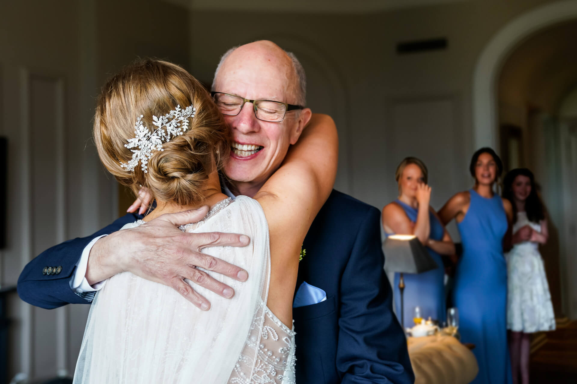 father of the bride hugging is daughter and smiling