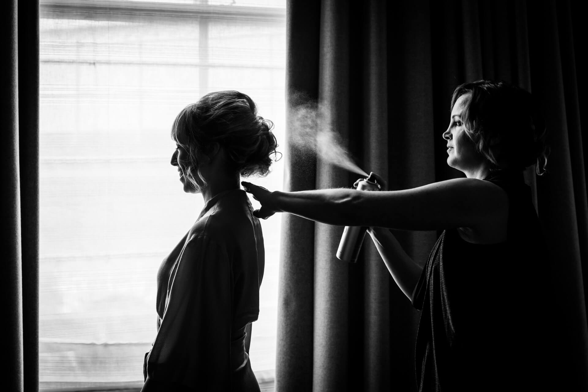 hairdresser fixing the brides hair at a york hotel