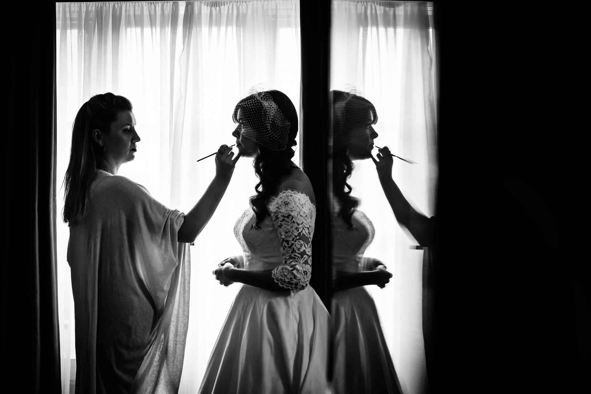 bride having her lipstick applied in a window of the Grand Hotel in York