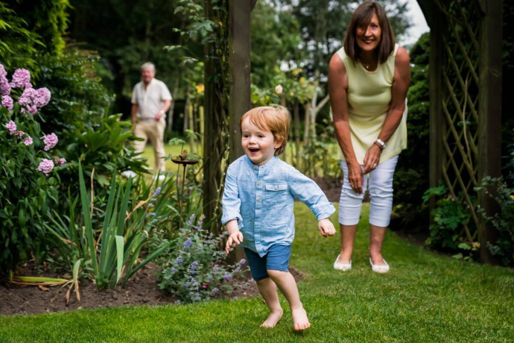 little boy running away from his grandmother