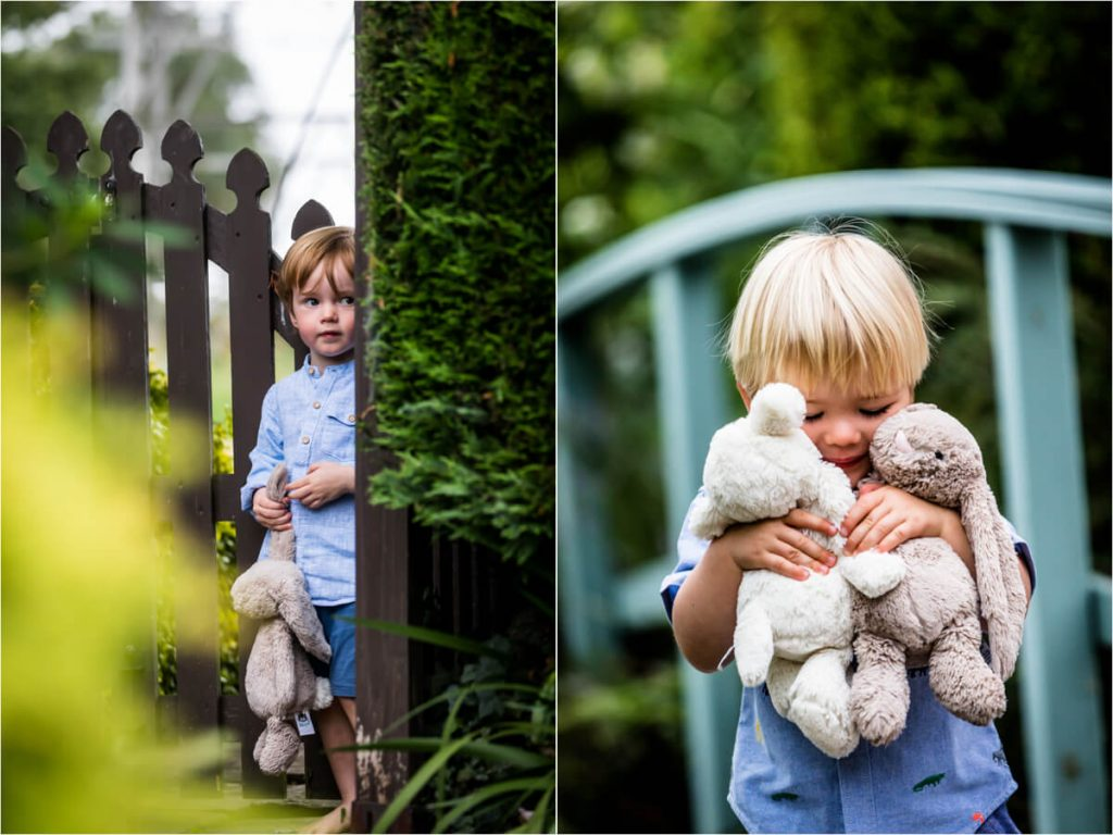 two little boys with their cuddly toys in a Yorkshire garden