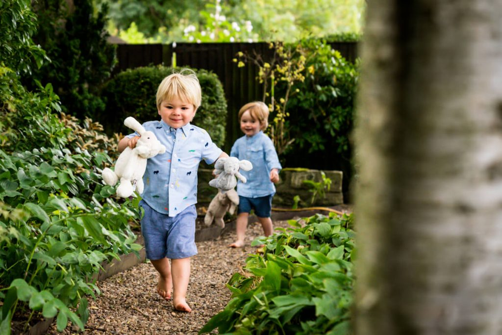 two toddlers running in a leeds family garden