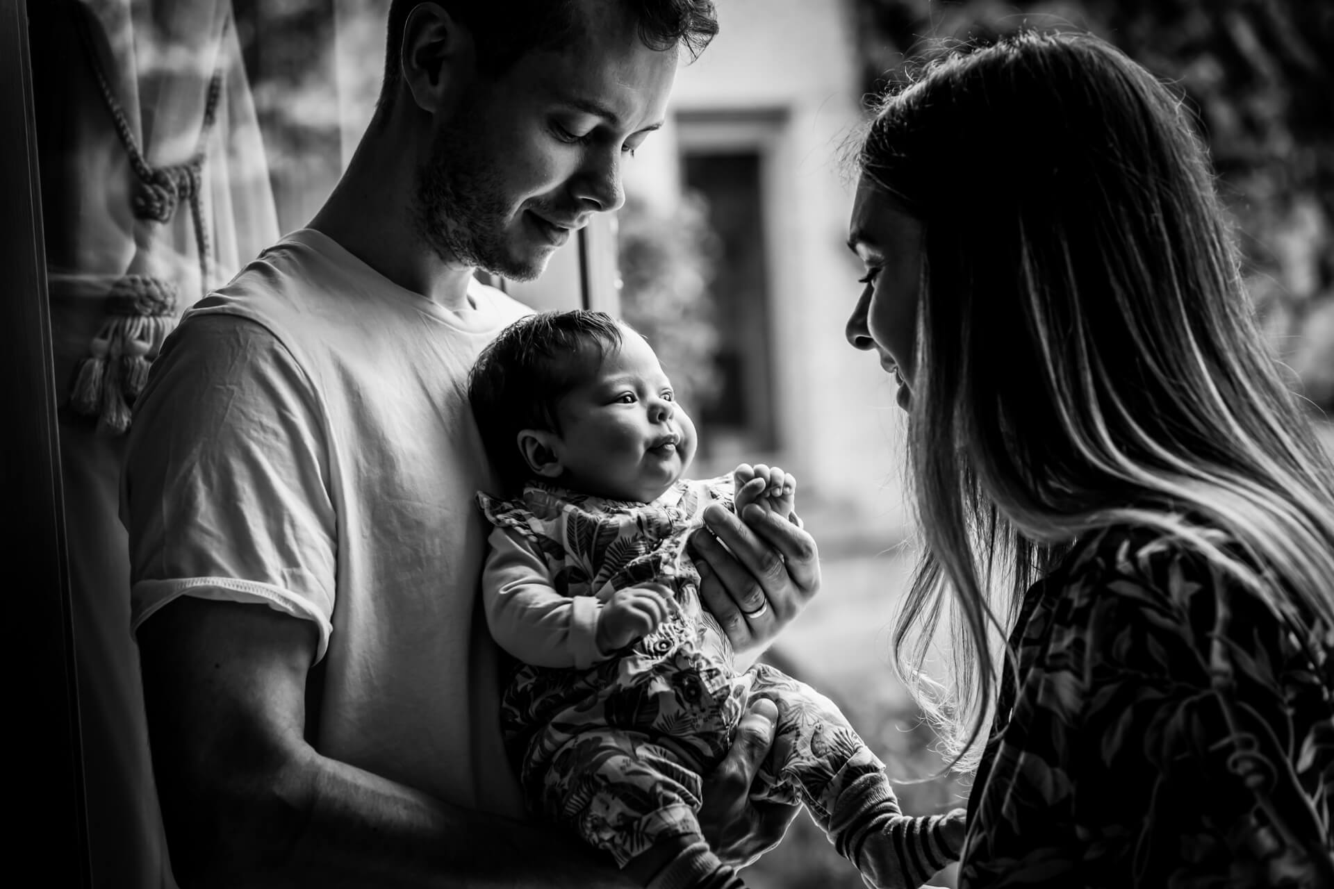 yorkshire baby photography- baby girl looking at her parents
