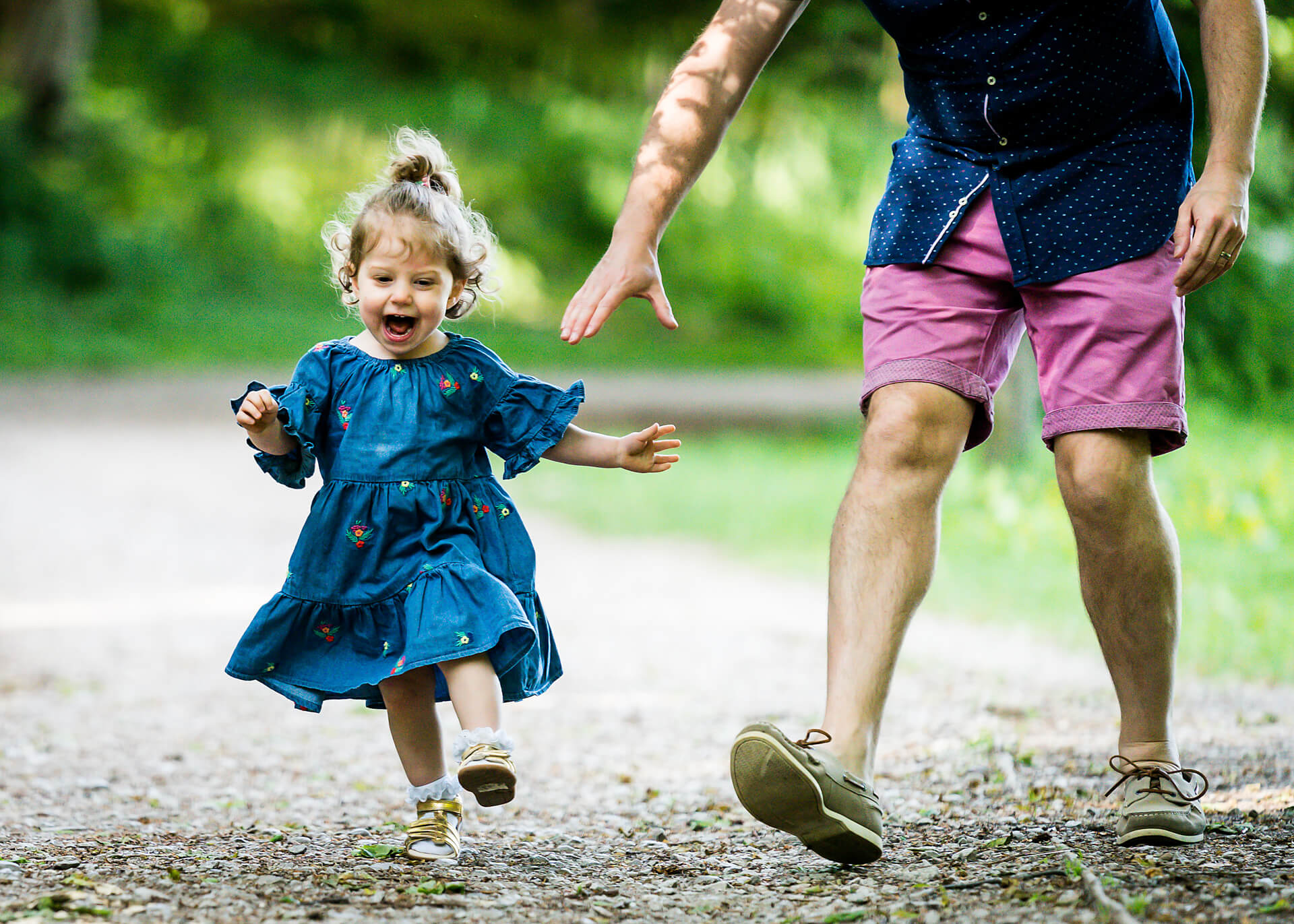 toddler running whilst being chased by dad
