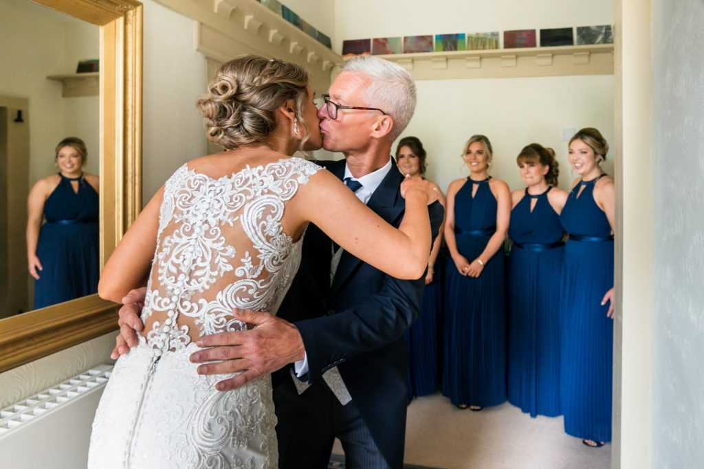 father kisses the bride