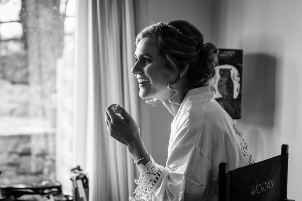 bride sitting in a window smiling