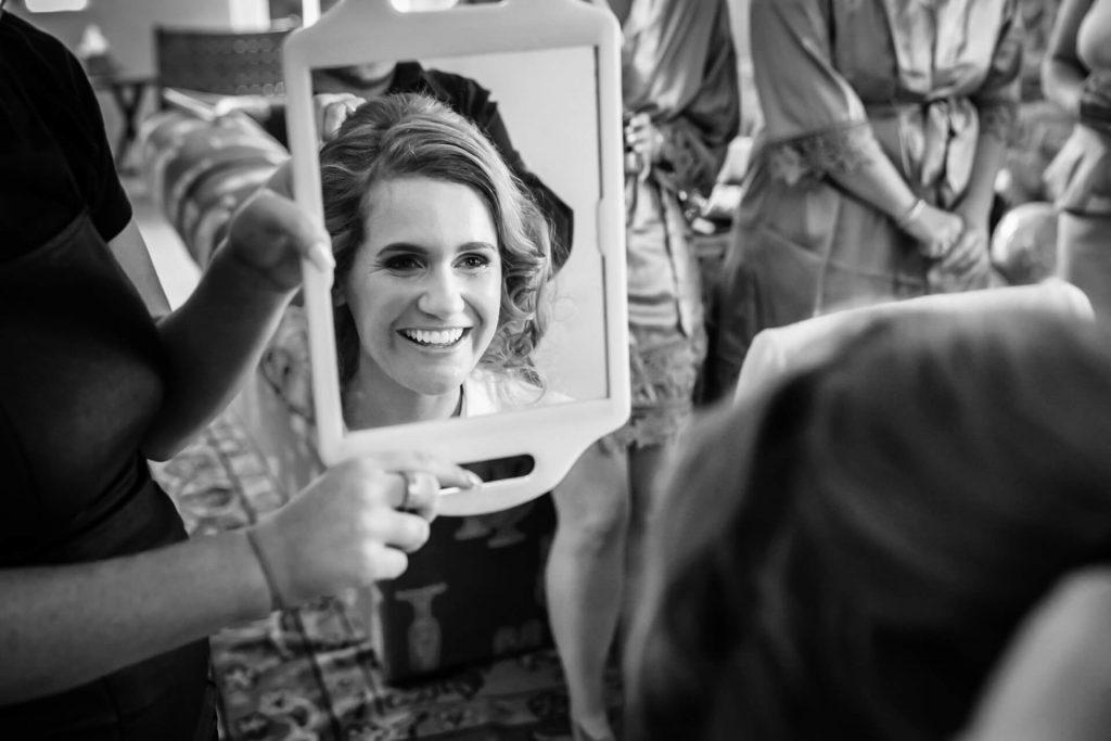 bride smiling in a mirror