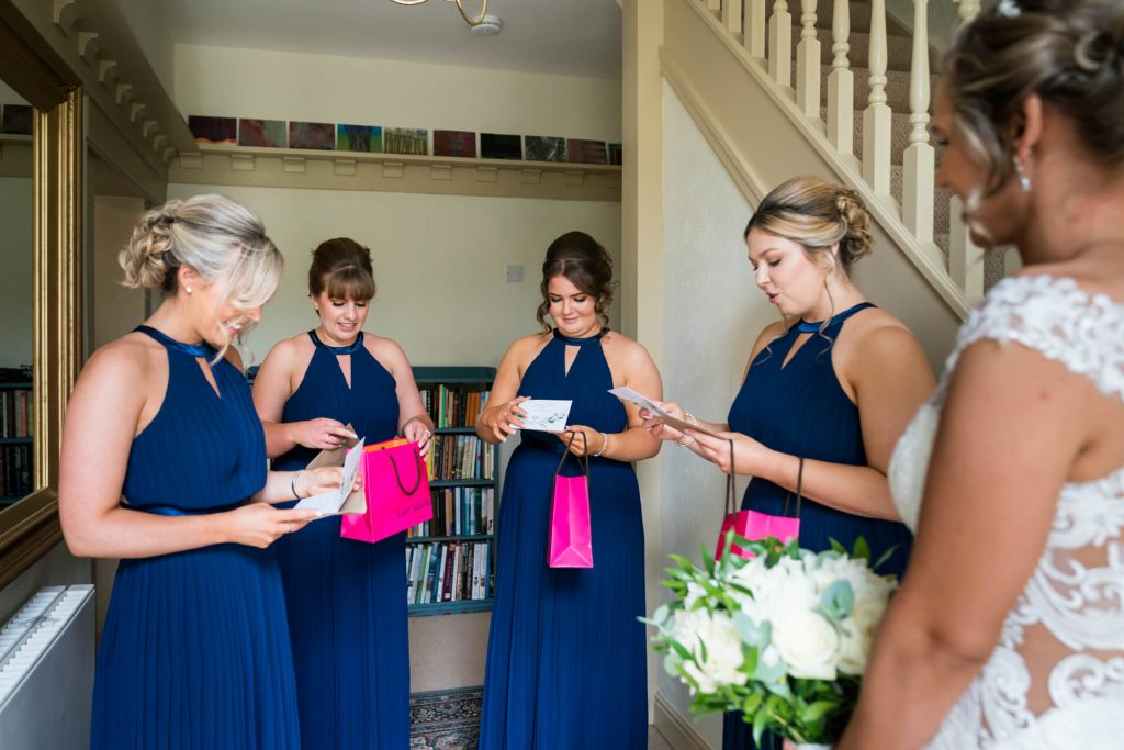 bridesmaids open their gifts