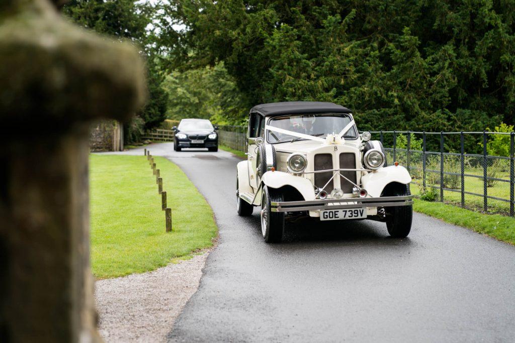 wedding car arriving at Bolton Abbey