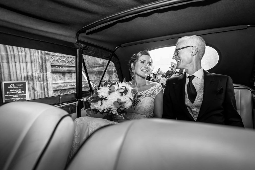 bride and father in the wedding car