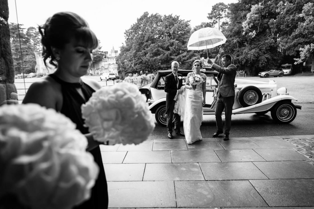 bride getting out of the car at Bolton Abbey