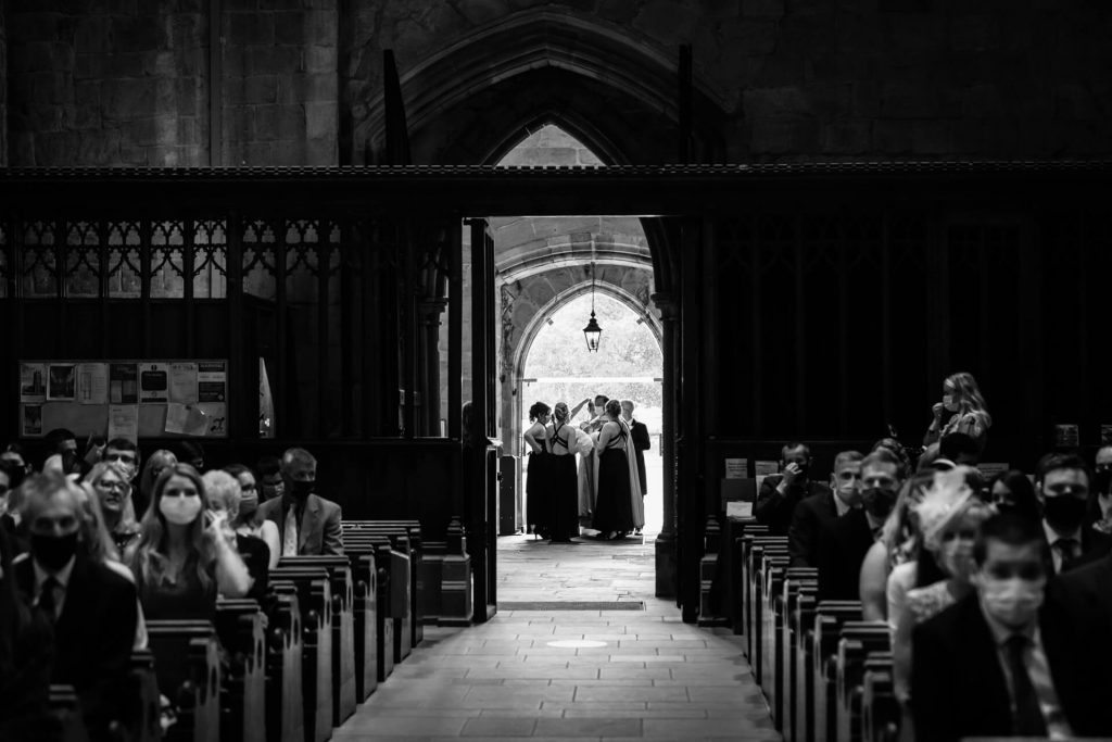 bridal party in the doorway of Bolton Abbey