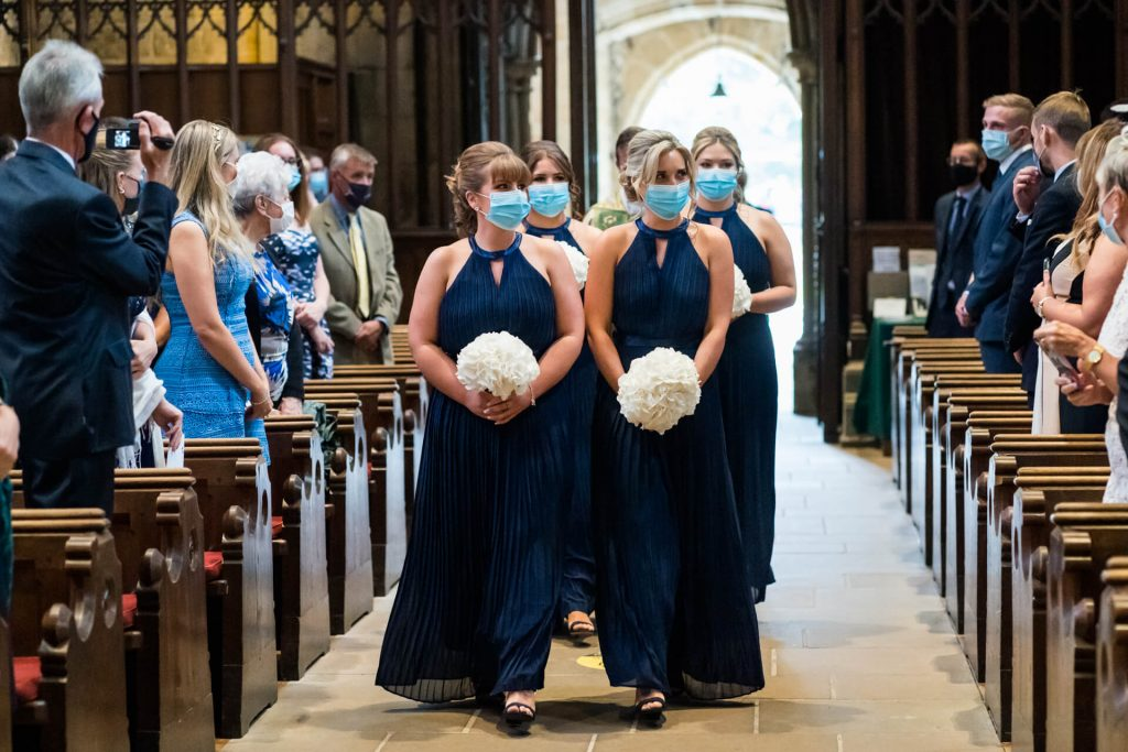 bridesmaids walking into the abbey