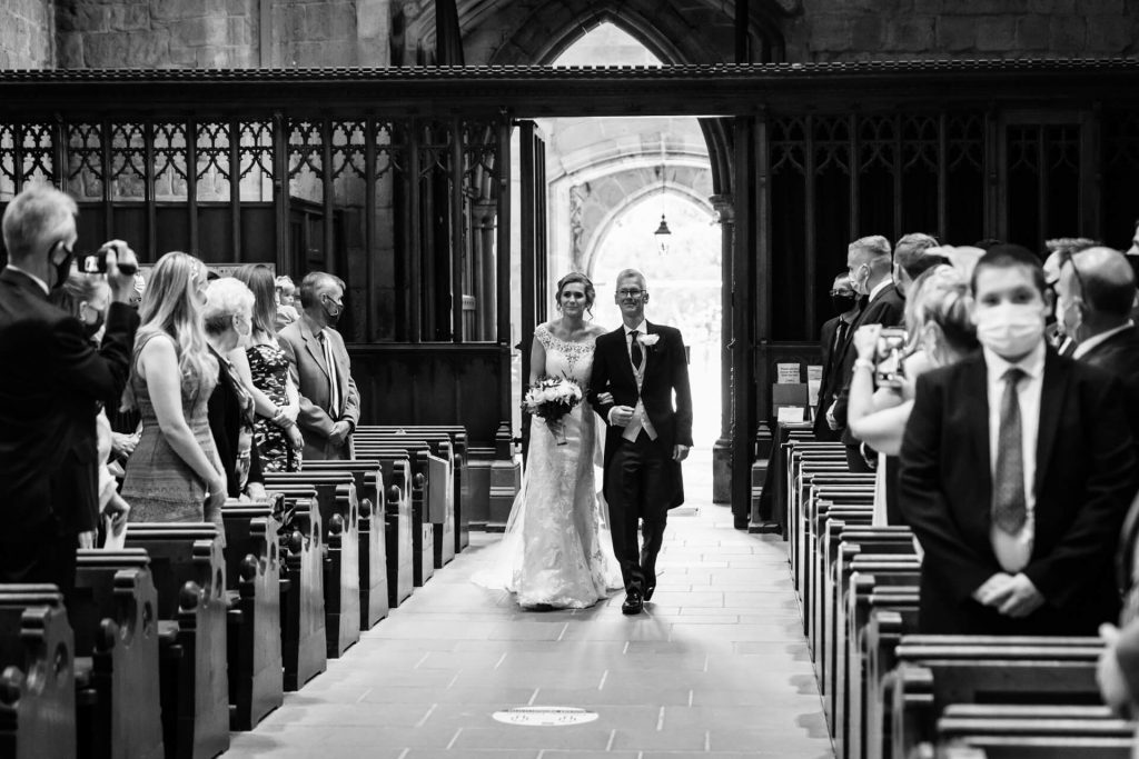 bride and her father walking down the aisle at Bolton Abbey