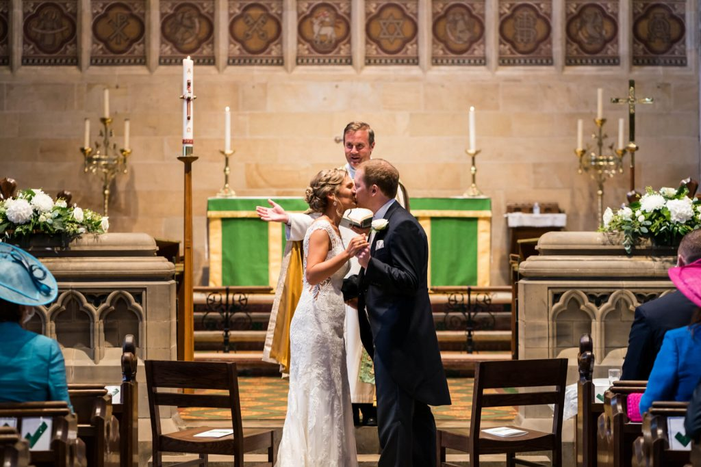 the first kiss during the ceremony at Bolton Abbey