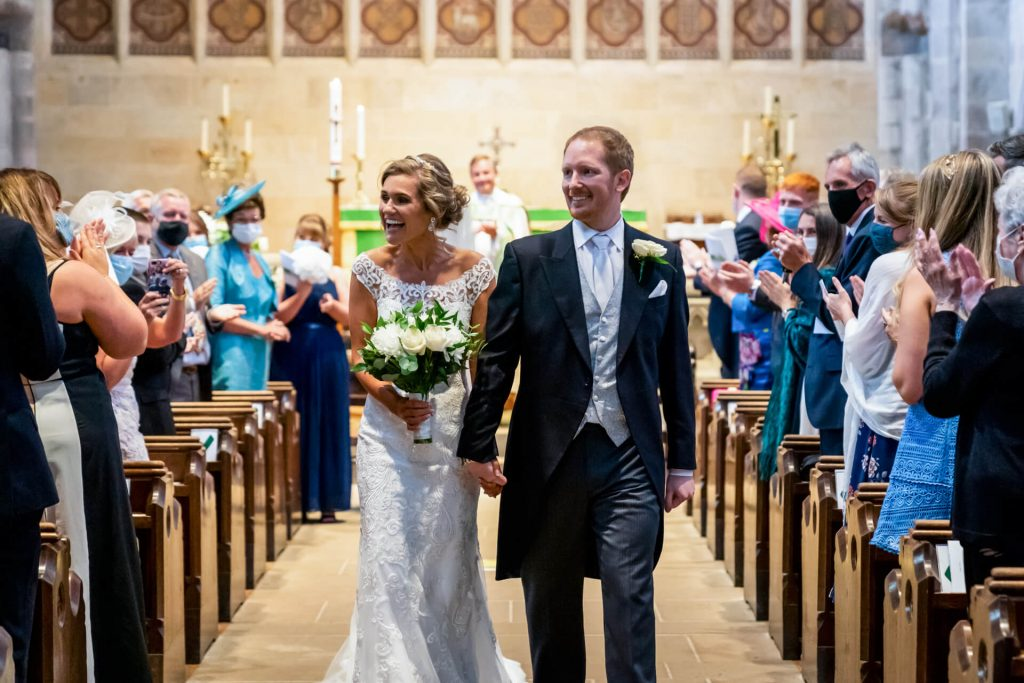 bride and groom walk down the aisle at Bolton Abbey