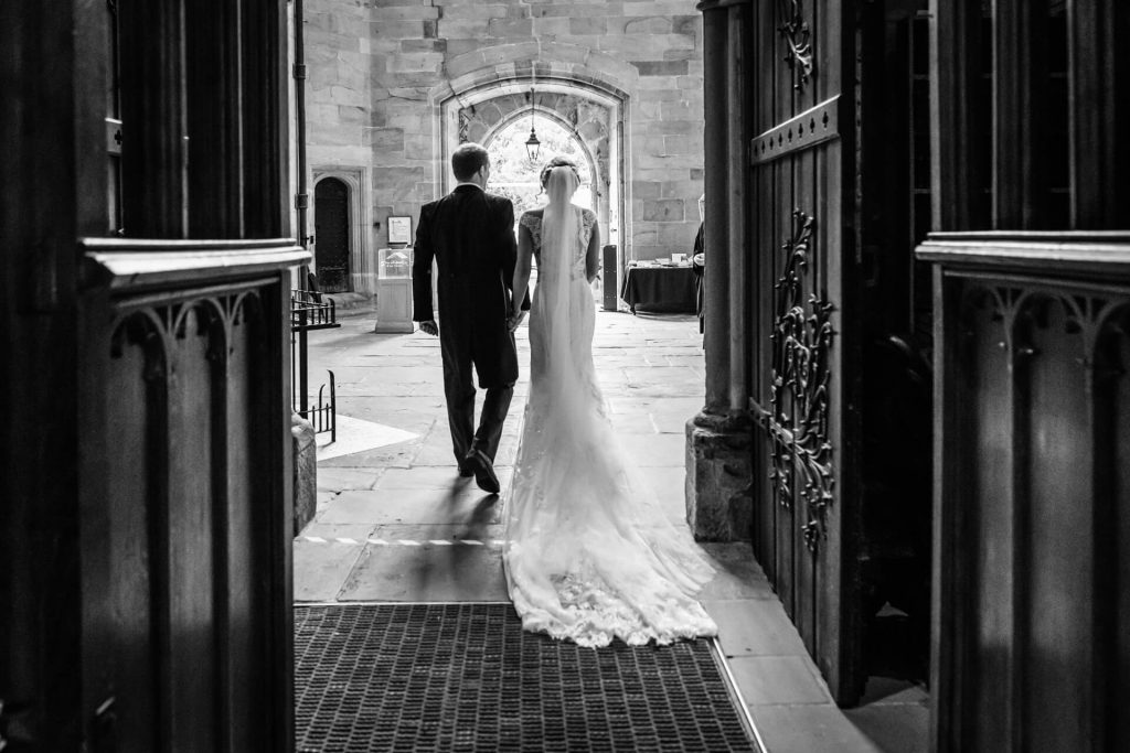 bride and groom leave the abbey