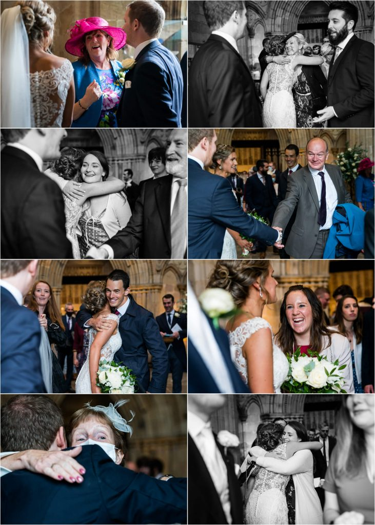 guests greeting the bride and groom as they walk out of Bolton Abbey