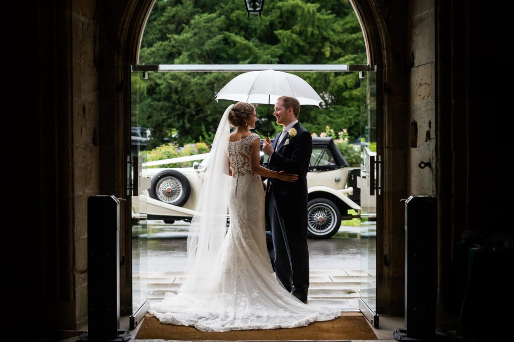 bride and groom portrait in the doorway of Bolton Abbey