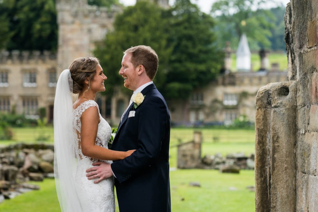 bride and groom portrait in the grounds of Bolton Abbey
