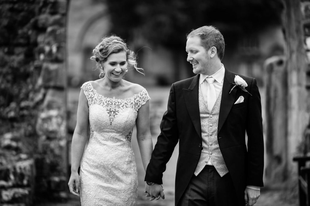 wedding couple walking in the grounds of Bolton Abbey
