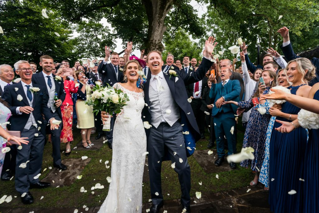 bride and groom under the confetti at Tithe Barn
