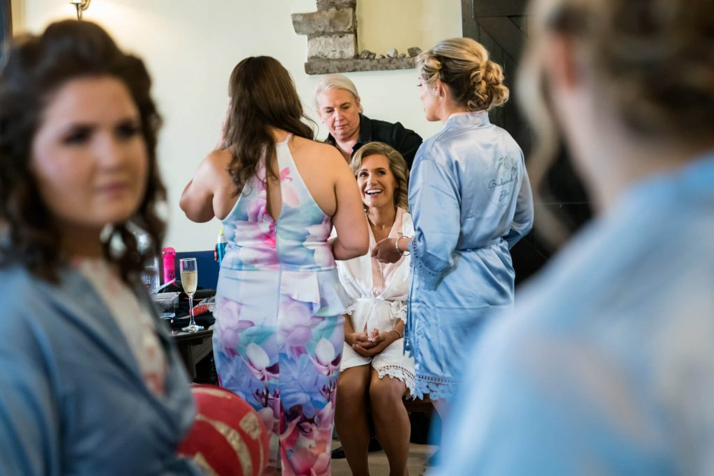 bride laughing with the bridesmaids