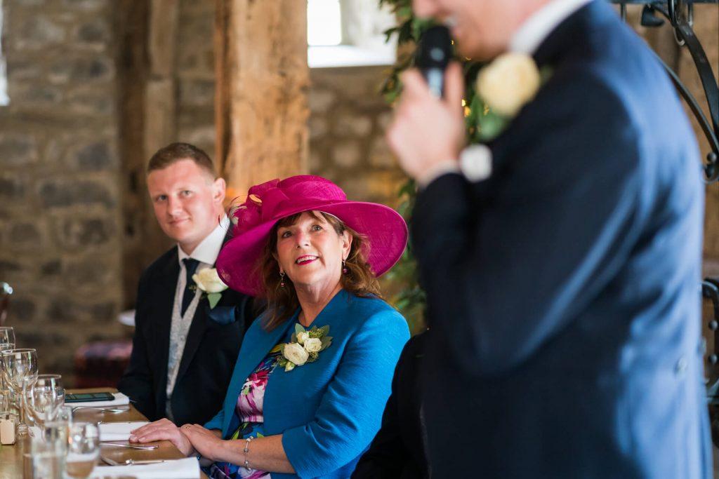 mother of the groom watching the groom speak